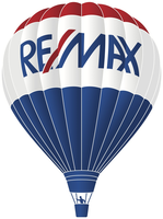 RE/MAX Homes & Hills Real Estate Inc Logo