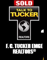 FC TUCKER EMGE REALTORS Logo