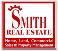 Smith Real Estate & Prop. Mgmt. Logo