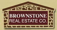 BROWNSTONE REAL ESTATE CO. Logo