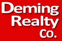 DEMING REALTY CO. Logo