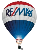 REMAX BY THE WATER Logo