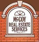 MCCOY REAL ESTATE SERVICE Logo