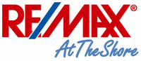 RE/MAX AT THE SHORE Logo